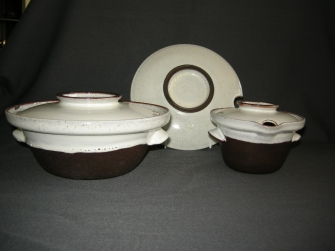 donkerbruin / wit gespikkeld